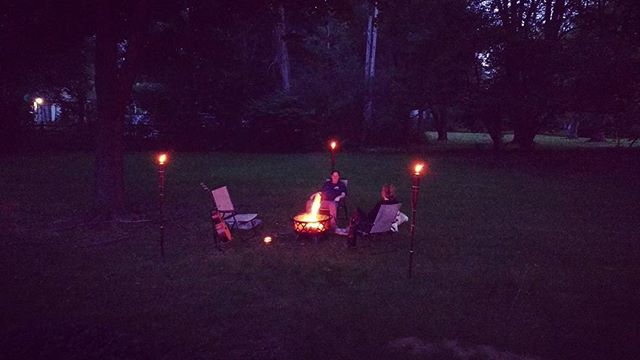 Backyard, now with tiki torches and a fire pit