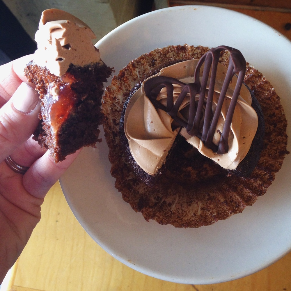 cupcake:chocolate, filling:strawberry preserves, frosting:Swiss chocolate buttercream