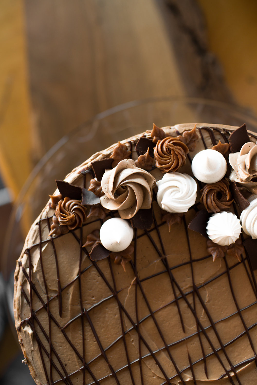 chocolate cake w/ swiss chocolate buttercream, ganache, and meringues.
