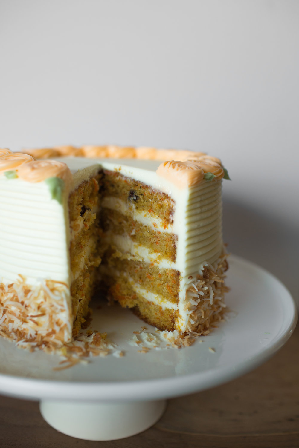carrot cake w/ cream cheese frosting and toasted coconut.