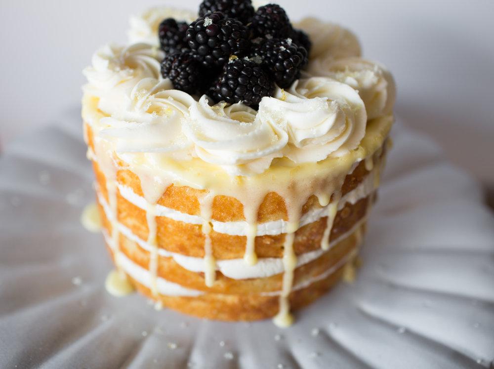 lemon cake w/ white buttercream, lemon curd, and fresh berries.