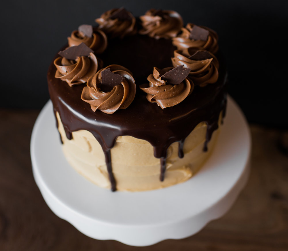 chocolate cake w/ peanut butter frosting, ganache, and chocolate buttercream.
