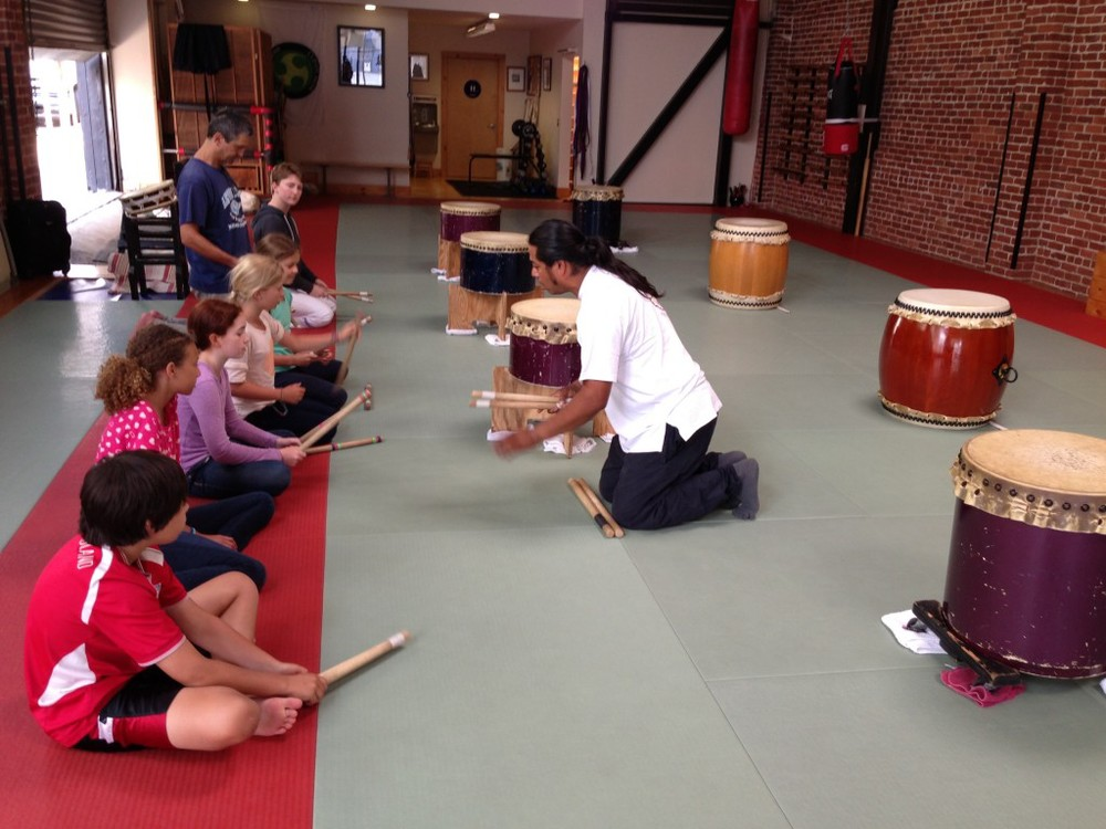 David of SF Taiko teaching taiko drumming to Camp Japan students at Suginami Aikikai, SF