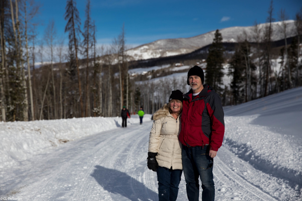 Roanne and Dave -- sledding with the kids.
