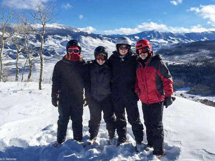 The guys out snowmobiling.