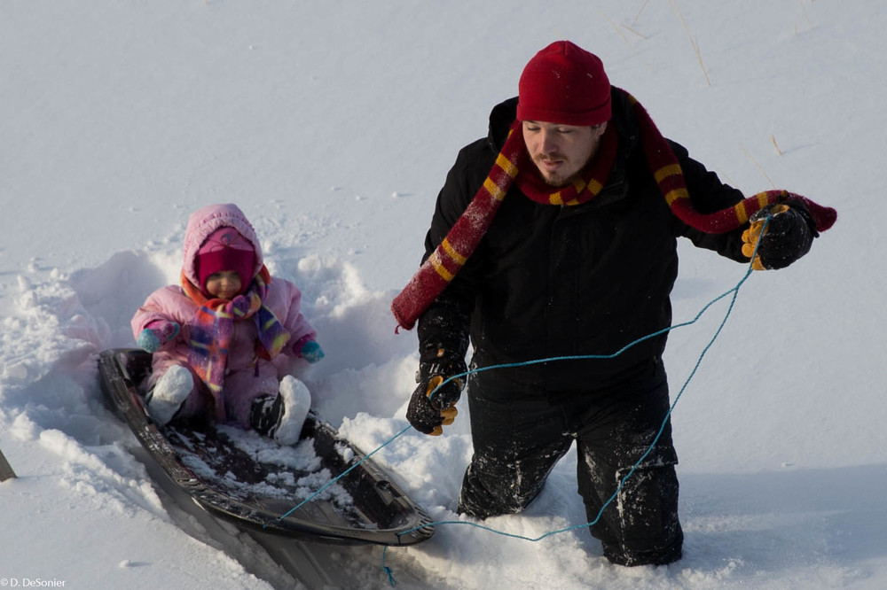 Uncle Mike taking Rosie sledding.
