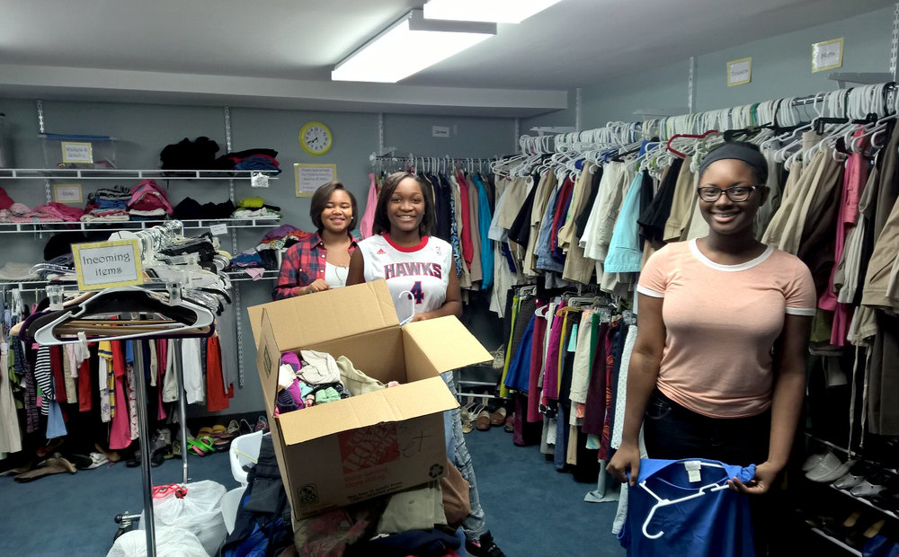 Infusion participants serving in the Clothes Closet as part of CVEM's Community Prayer Breakfast team.
