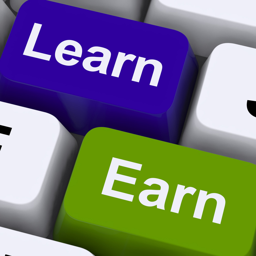 Learn And Earn Computer Keys Showing Working Or Studying