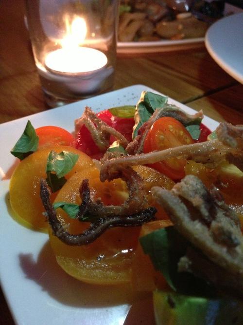 Milan's tomatoes, crispy pig's ear, basil