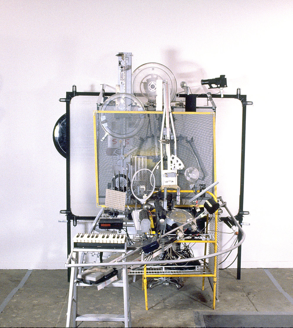 ' Cybernetic Keyboard ', size variable, Test-Site Gallery, Brooklyn, 1992 The Cybernaetic Keyboard has the two-octave keyboard controlling an elaborate arrangement of audio-visual electronics including rotating motorized objects that cast shadows, live radios, cassette tape recorders with loops, a TV set, and other miscellaneous objects allowing the viewer/participant to improvise a multi-disciplinary art/sound piece on the spot.
