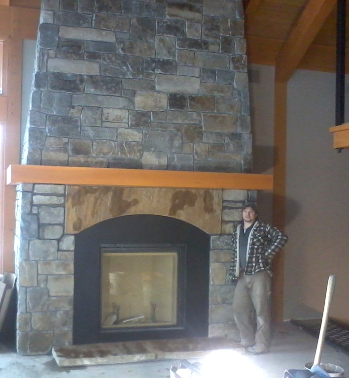 Ryan with custom Moose Mt. Ledgestone & Square's N Rec's thin veneer blend with Sandstone Lintel.