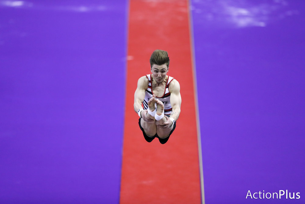 Sam Oldham of Great Britain performing on the men's vault.