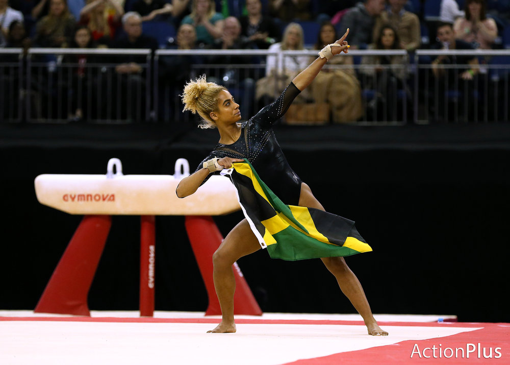 Danusia Francis of Jamaica performing on the floor with the Jamaica flag.