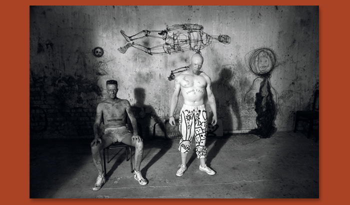 Roger Ballen (b. 1950 in New York, active in South Africa),  Muscleman and Ninja , 2012, photograph, 11 x 13 3/4 in., courtesy Roger Ballen