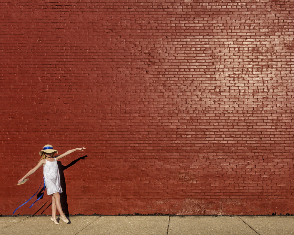 Girl at the Red Brick Wall, by Raymond Jude Kaider. All rights reserved.