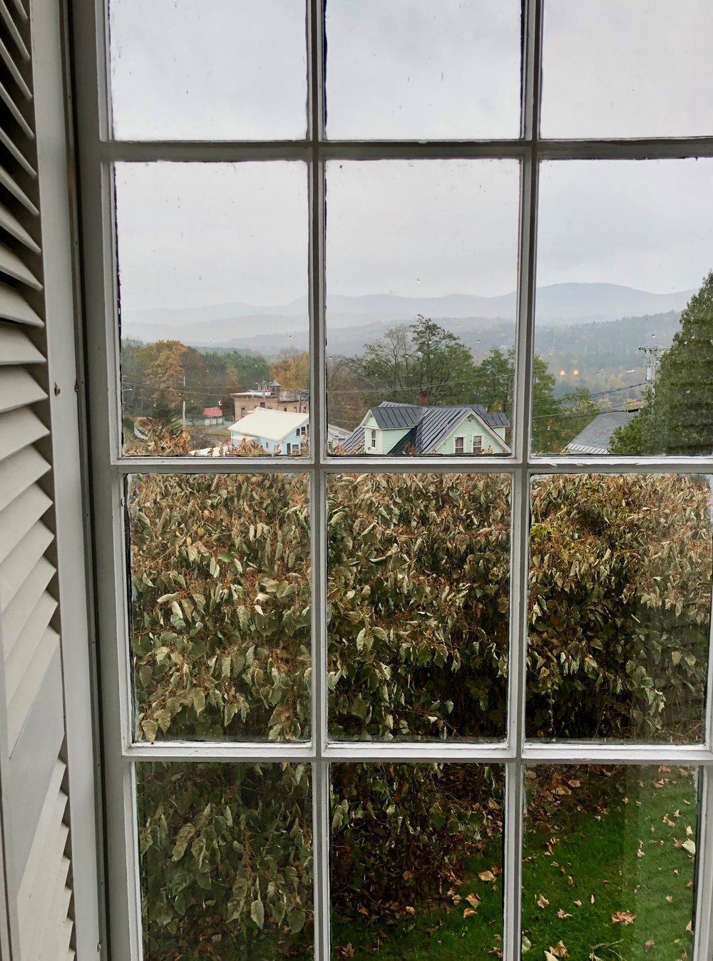 rainy new england seen from the window of the church