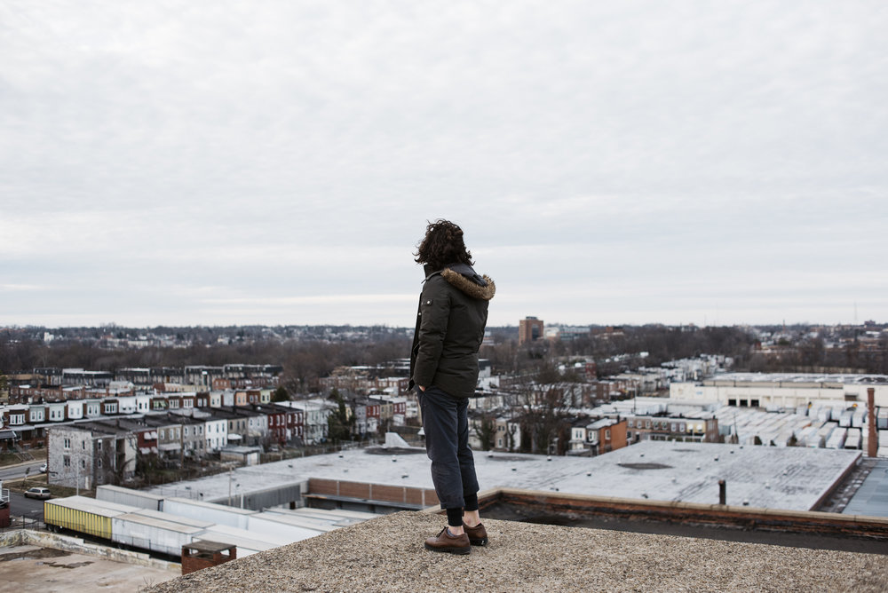 Portrait of Moses Hubbard on rooftop in Baltimore Maryland| Photography by Jack Sorokin