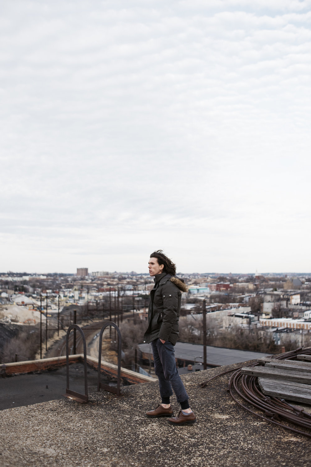 Portrait of Moses Hubbard on a rooftop in Baltimore Maryland| Photography by Jack Sorokin
