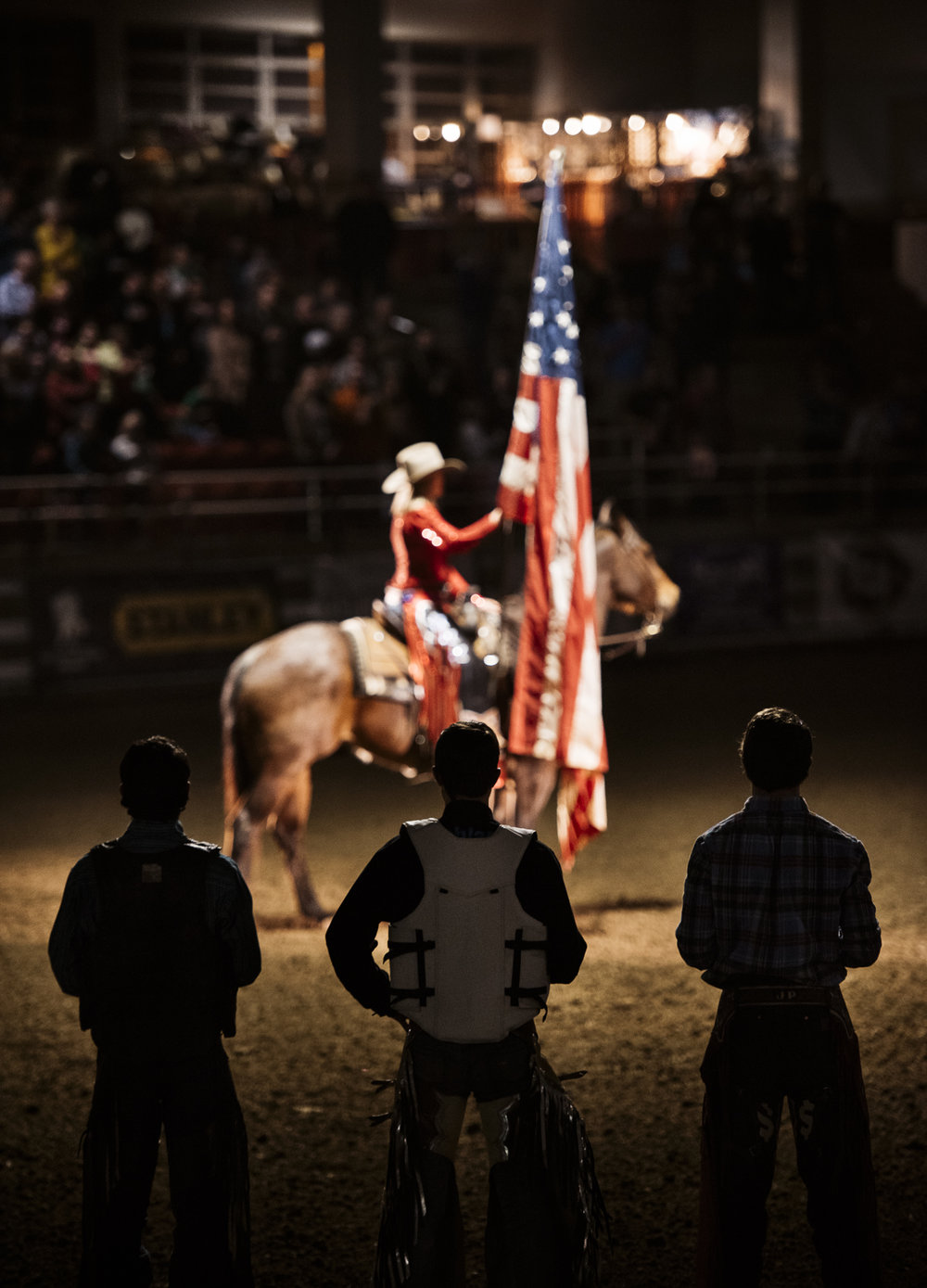 American Flag at bull riding BullMania 2017 rodeo event in Asheville North Carolina at the WNC agricultural center, photography by jack sorokin