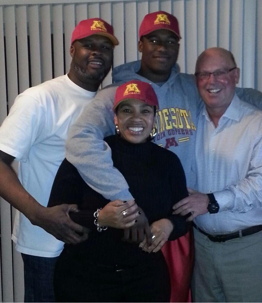 Melvin Jr, his Dad Melvin Sr, and Melvin Sr's girlfriend Marsha enjoy a Official Visit snapshot with Coach Kill.