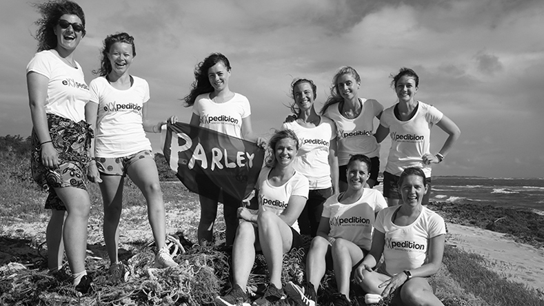 eXXpedition-North-Pacific-crew-with-partner-Parley-for-the-Oceans-banner-ahead-of-the-voyage-(c)-eXXpedition.jpg