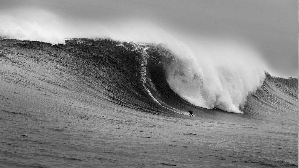 """The above image of Greg, in the words of photographer Al Mackinnon: """"I've been blessed to have seen some breathtaking sights, but this particular moment will live long in the memory. This photograph of Greg Long riding this monster at Dungeons, South Africa, won Greg and me the Billabong XXL Biggest Wave Award 2006/7 (now WSL Big Wave Awards) for ride and photograph. Incredibly, Greg is not just a phenomenal surfer, but also a gifted orator, particularly in raising awareness for environmental causes worldwide.""""See more of Al's incredible work  in this article ."""