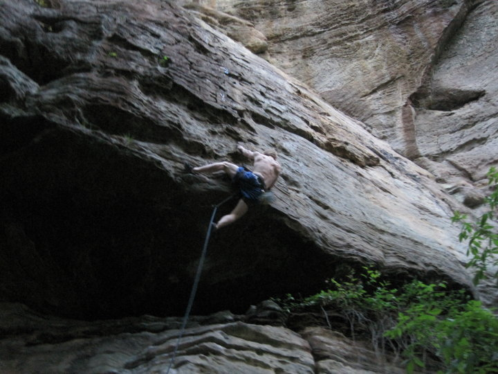 Pulling the roof on Creature Feature - a classic moderate at the Red River Gorge