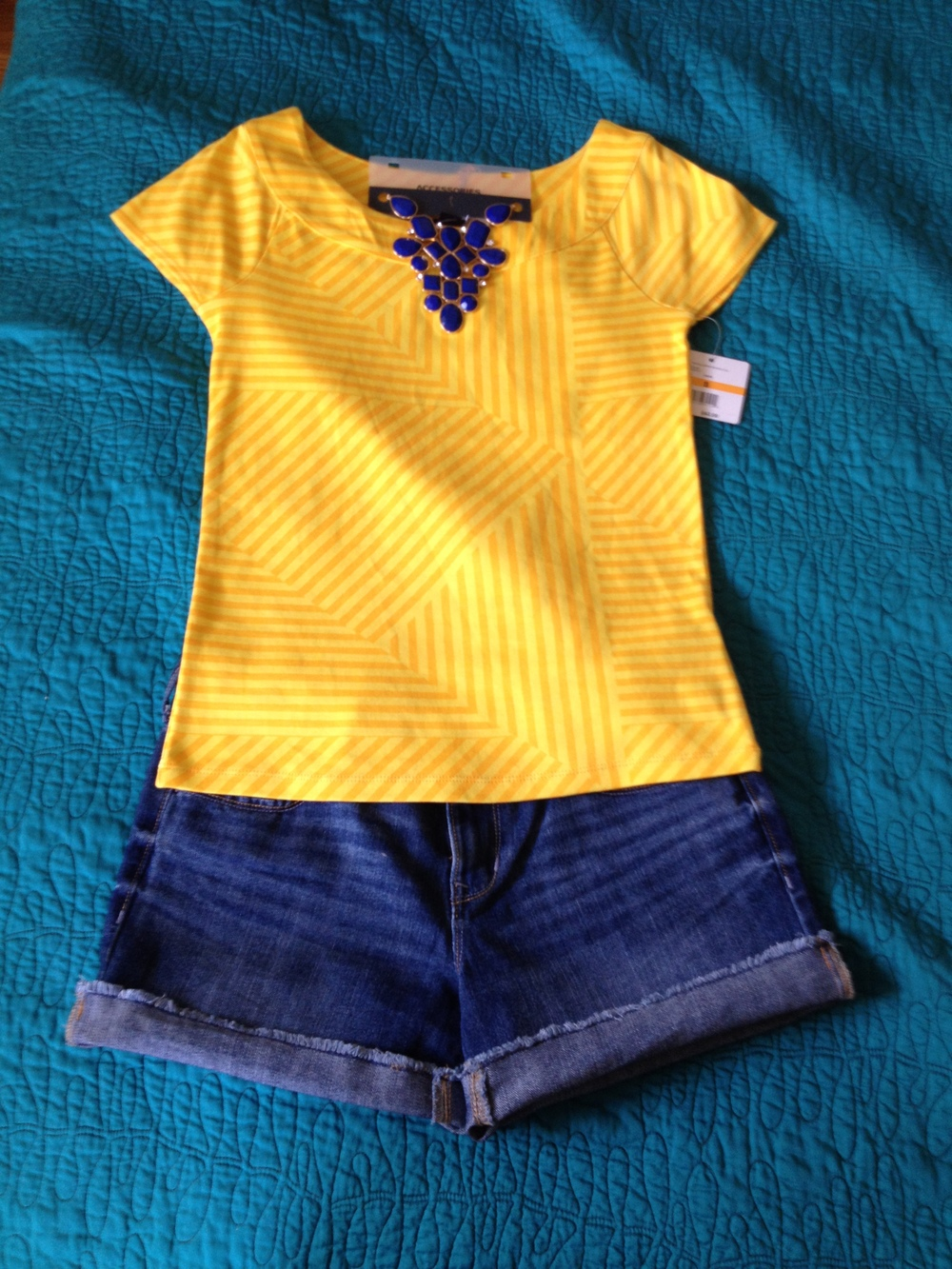 This is a fun top I picked up at Ross for $14. We ended up not using it but I liked it because of the bright color and subtle print. My plan was to fold the bottom under to make a crop top for the model to wear with jean shorts and a bright and fun statement necklace! The necklace is from OldNavy and was $20. Jean shorts are mine and are also OldNavy.