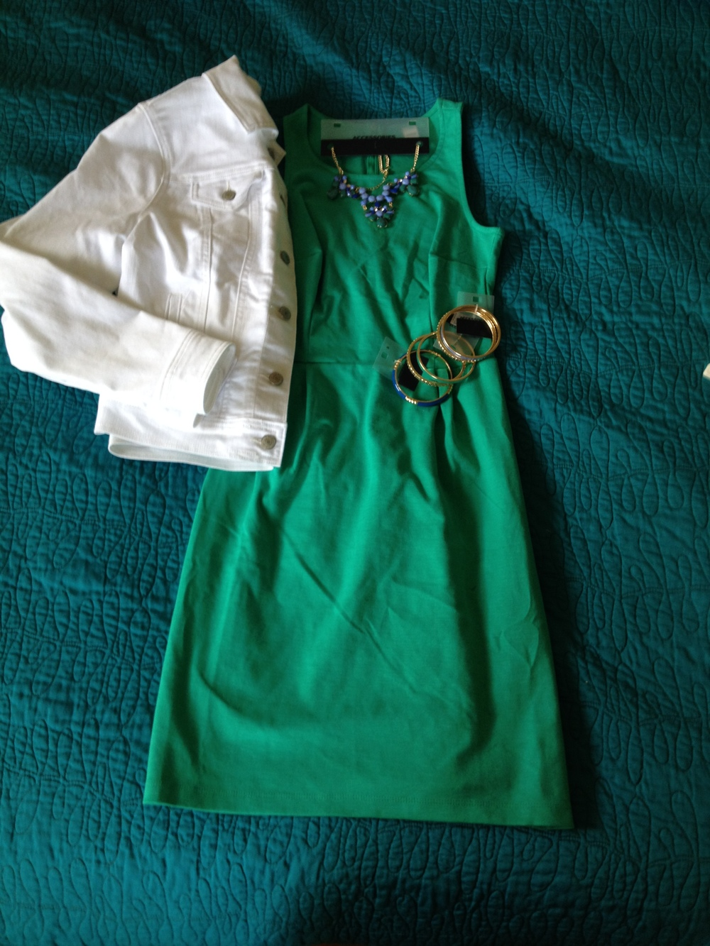 This is a fun dress that I found at OldNavy on sale for $20. You can't really tell in this photo, but the color is super bright and fun. This was actually one of my favorite Crayola Crayon colors back in the day and the shade is 'Jungle Green'. The jewelry is also from OldNavy and was around $8-$20 per piece. The denim jacket is OldNavy as well for $30. While I love the look of the bright white against the green in real life, I discovered at the shoot that it didn't photograph well. The white was just TOO white and affected the light balance in the photo. Lesson learned. :) We did not end up using this dress or jewelry in the shoot, but we did take a few photos with the jacket.