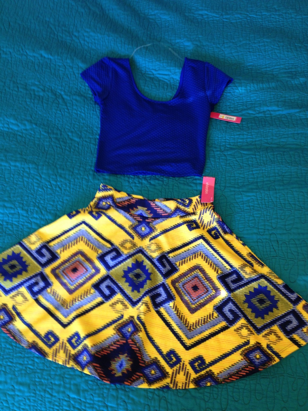 This outfit was possibly one of my favorites from the shoot. It's a simple crop top and skater skirt both from Target in the same collection. The bright colors looked amazing in the photoshoot! :) TargetDoesItAgain!