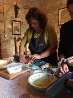 Gabriella prepares the lamb.