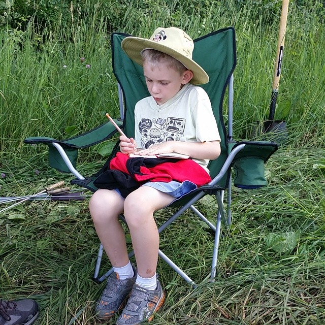 Filling our camp journal #camping #relaxed #nature #writing