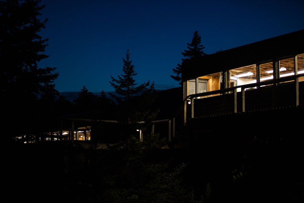 Wood studio (left) and Ceramics studio (right) illuminated at nighttime, 2016.