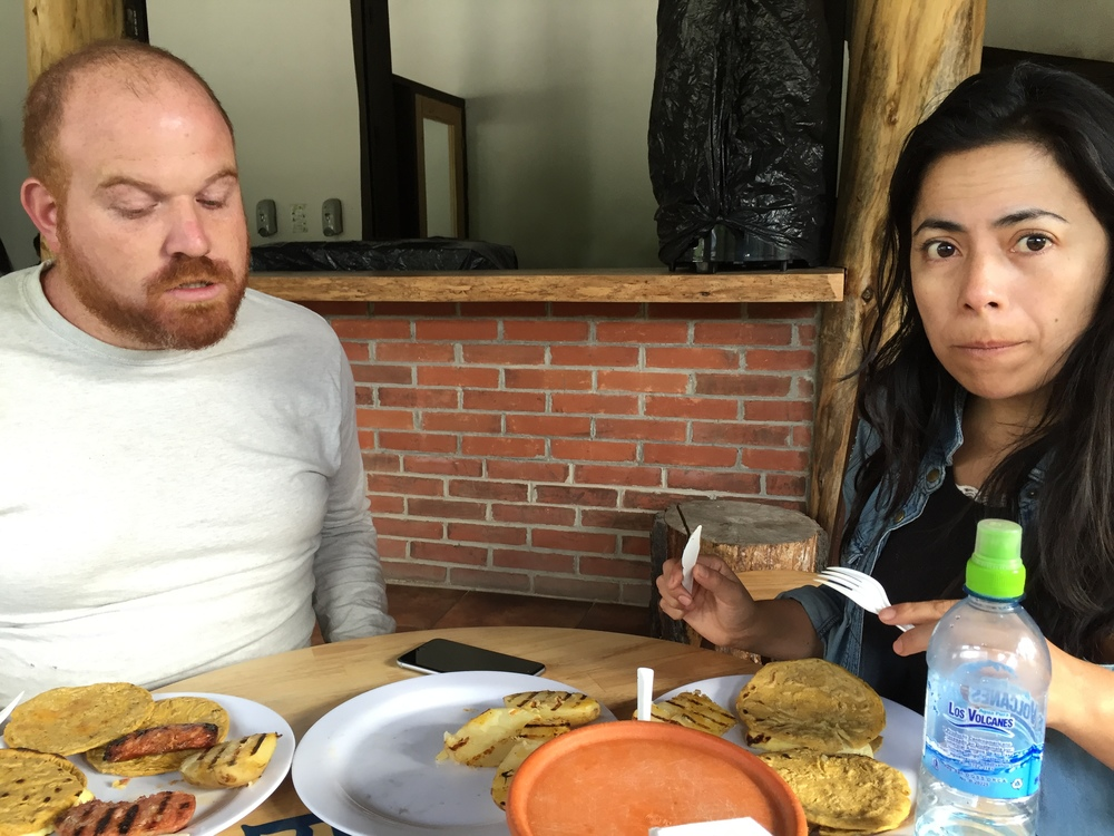 Jesse and Heidi, mid-afternoon snack. Chorizo, queso, papas, linguica, cafe con leche.