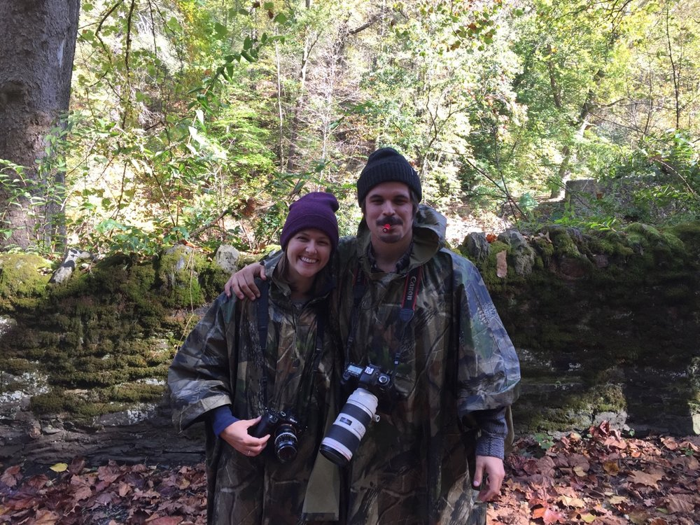 Your photographer couple. Looking forward to using this camo + bird caller to be even more discrete than you thought was humanly possible. Available for outdoor engagements, funerals, divorces, and births worldwide! We're your last-minute videographers, but never your last-choice!
