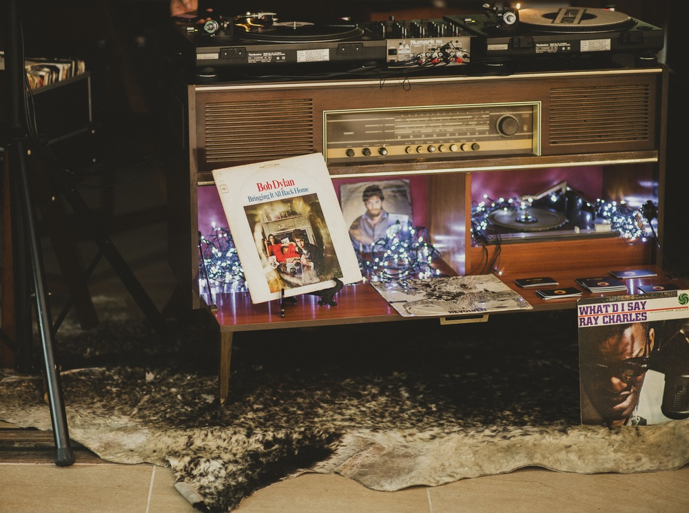 ONE OF OUR retro Dj StationS in action! Photo by All Grown Up Weddings