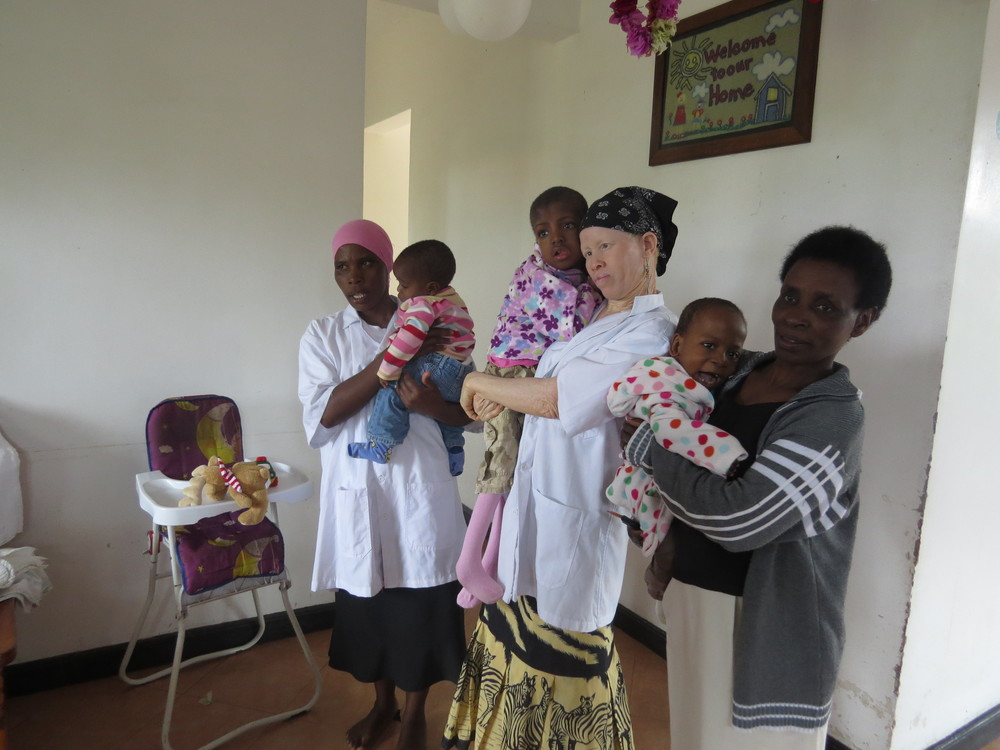Our dedicated TUMAINI HOUSE 'special unit' staff with LIA's nurse and small children.