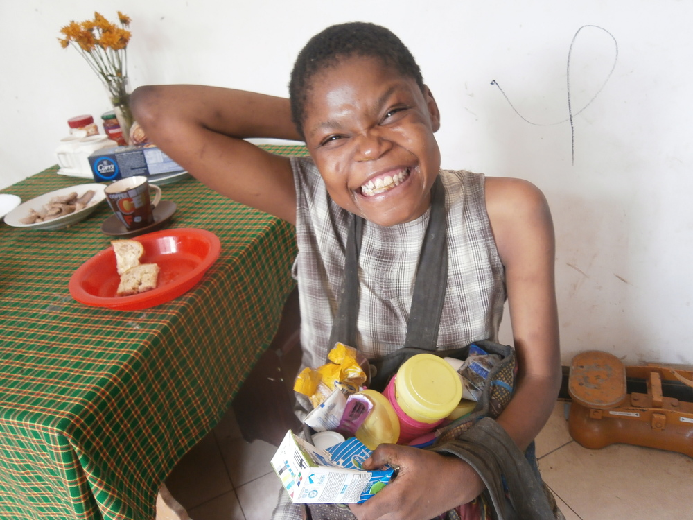 Mary was brought by the police into our care from a very traumatic expereince.  It will take many month's of TLC before she feels safe and secure, but this is the first picture of a smile.  Mary collects everything in a bag that I gave to her, - she even helps herself to eggs from my house after she has climbed through the open window!