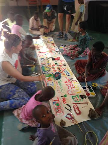 Students and children enjoying an art and craft session.