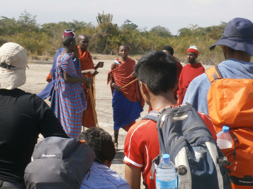 Students paying attention to some exclusive explanations about the nomadic tribe