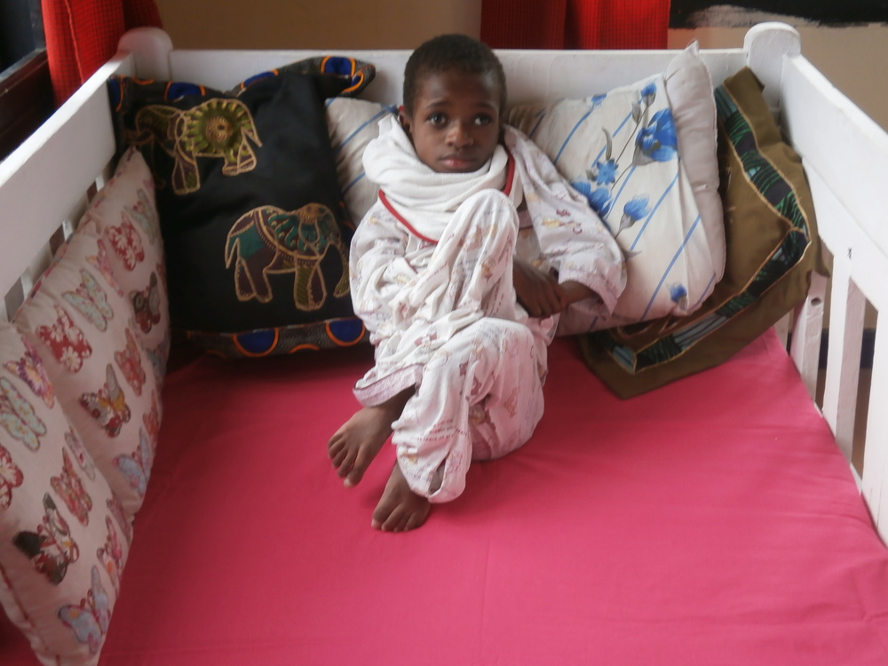 Lucy is the saddest child you could ever meet. With severly distorted legs form being broken and not receiving medical care from her grandmother. We have cared for Lucy for 3 yrs but have never seen her smile once.