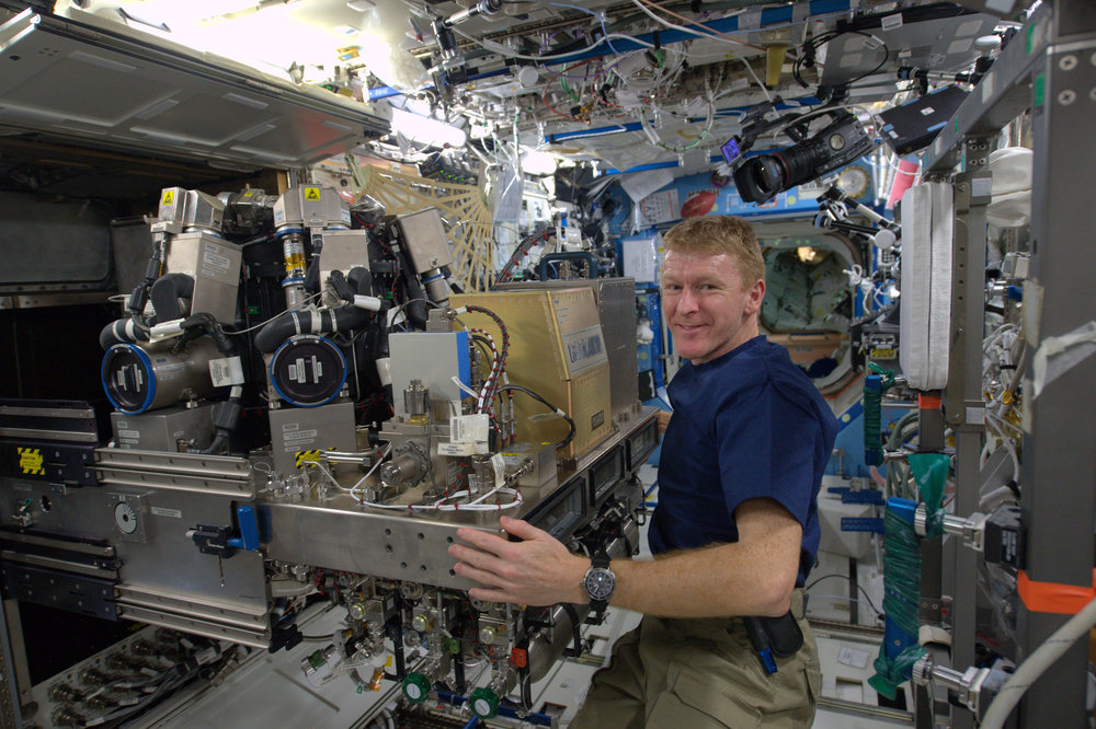 Tim at work on the International Space Station courtesy of ESA/NASA