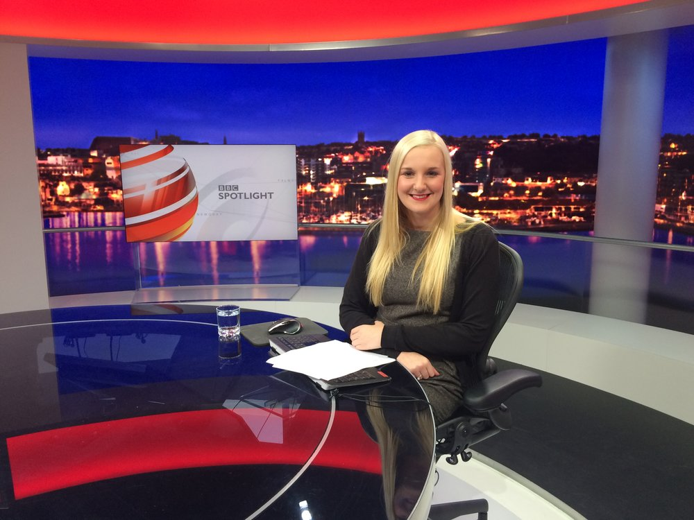 Claire Jones presenting a news bulletin in the TV studio