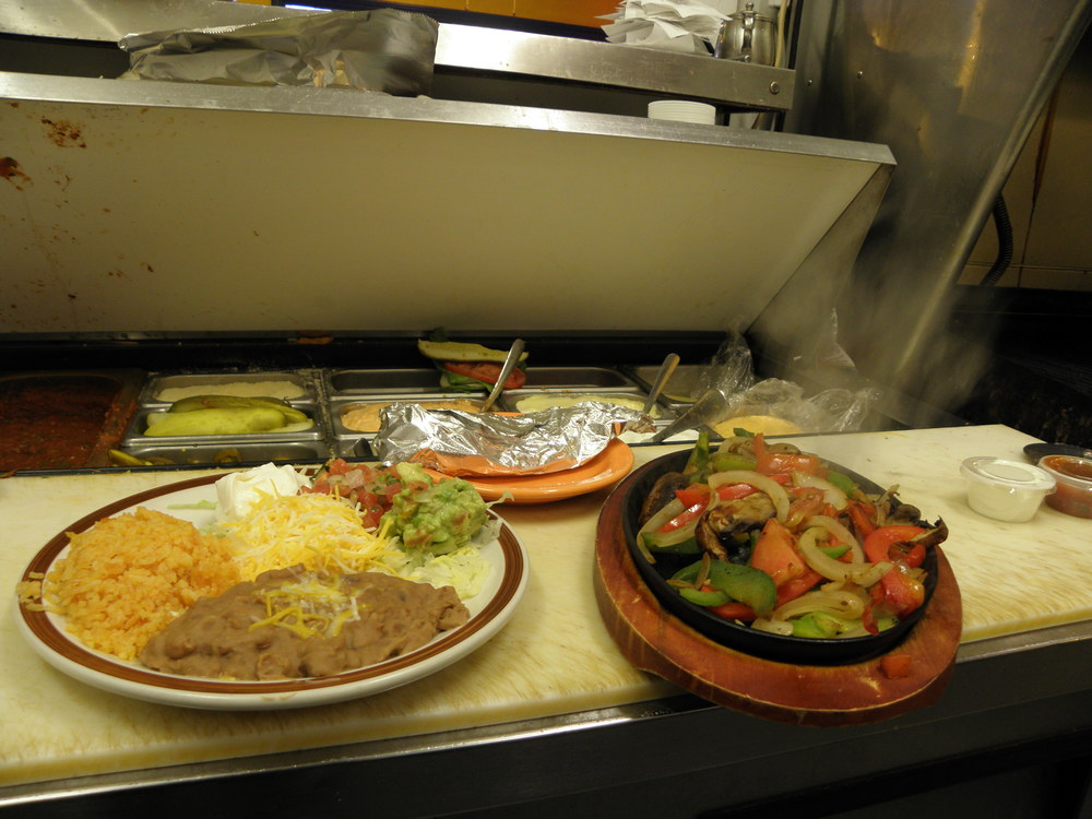 Our steaming hot fajitas and all the fixings ready to go out!