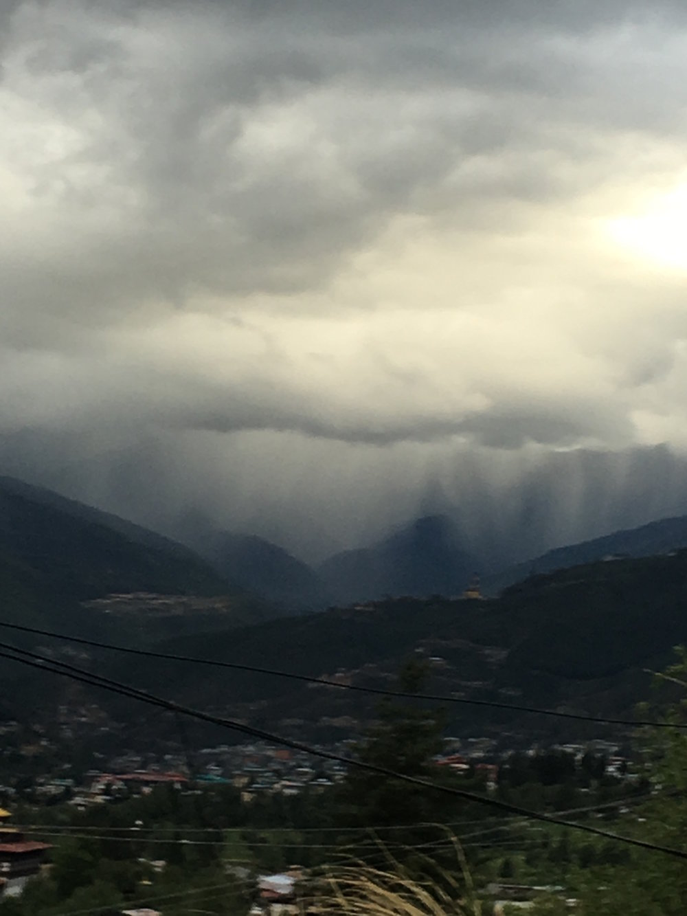 A summer storm makes its way across the Thimphu Valley. This particular storm blew through in about 15 minutes. It looks ominous but was very mild.