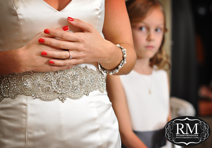 Flower girl contemplating bride's last moments as a single woman, before walking down the isle