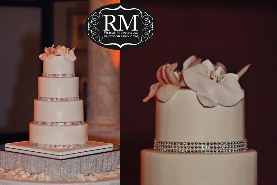 Stunning 4 tier wedding cake accented by natural orchids