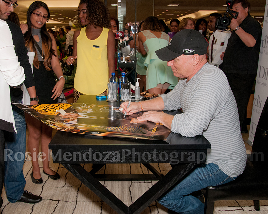 "Shoe designer Steve Madden greeting 1st in line fans Richard and Vanessa Monesar while signing their ""The Wolf of Wall Street""   poster"