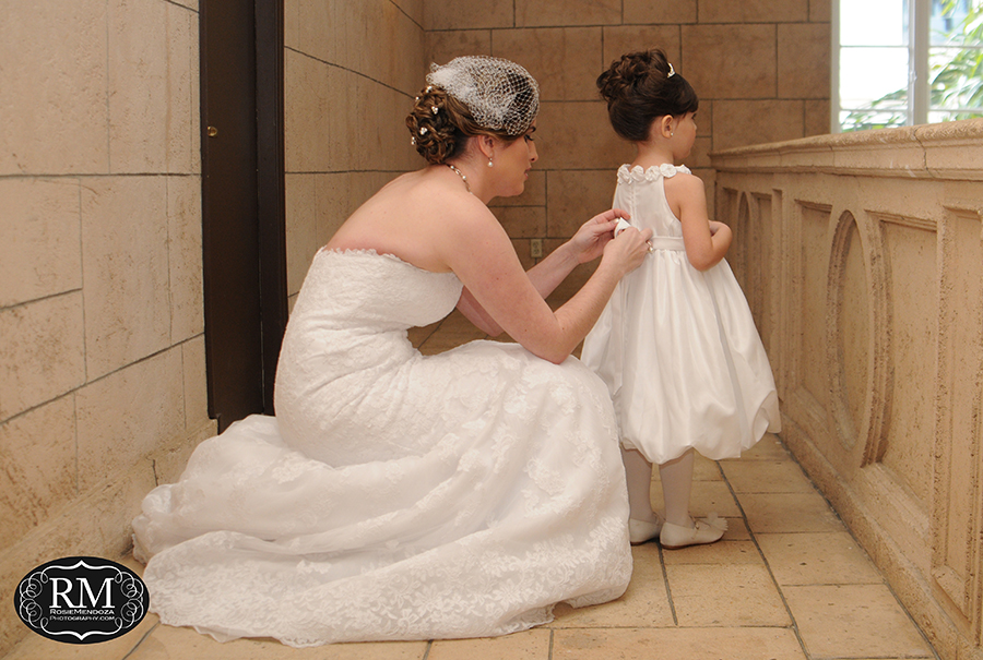 Last minute details between bride and flower girl