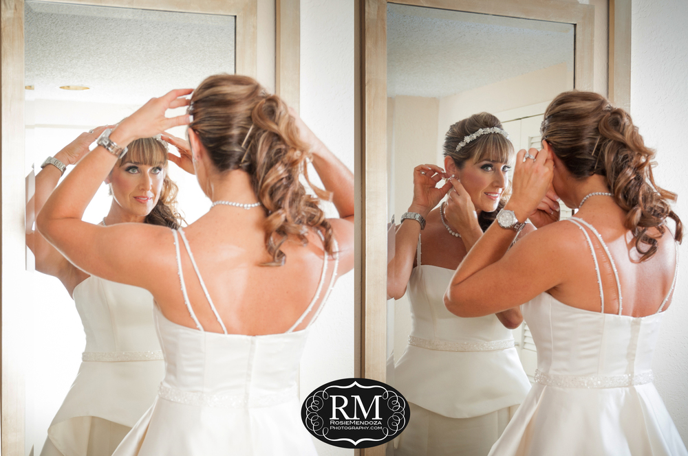 My gorgeous bride getting ready… her dresses complemented the groom's black tuxedo and matching silk tie.